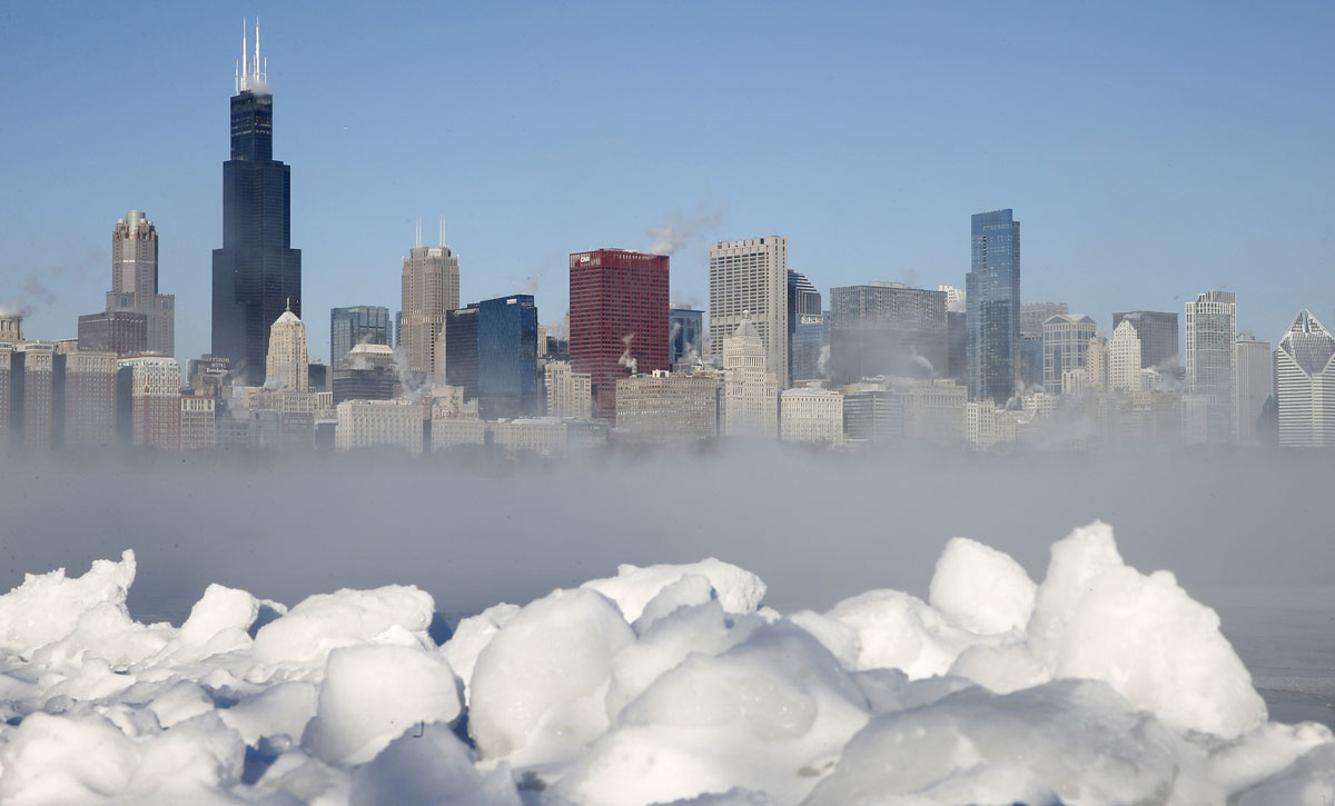 Chicago skyline is seen beyond the arctic sea smoke rising off Lake Michigan in Chicago
