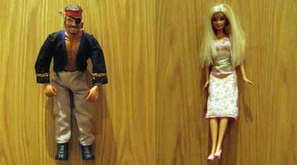 Pirate vs Barbie Doll Toilet Sign